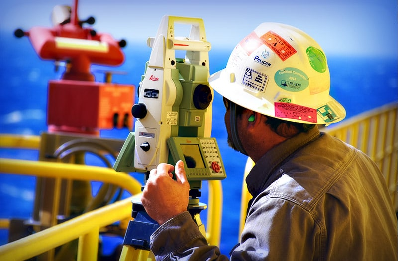 Man performing laser scanning survey on rig